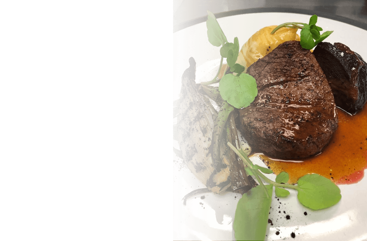 Duo of dexter beef, fillet & cheek creamed potato, grelot onion and smoked garlic jus.